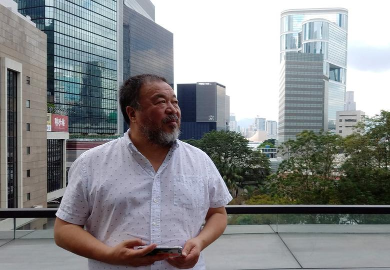 Chinese artist Ai Weiwei poses in downtown Hong Kong, China April 19, 2017. REUTERS/Venus Wu