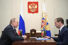 Russia's President Vladimir Putin (L) meets with Prime Minister Dmitry Medvedev at the Novo-Ogaryovo state residence outside Moscow, Russia April 17, 2017. Sputnik/Aleksey Druzhinin/Kremlin via REUTERS ATTENTION EDITORS - THIS IMAGE WAS PROVIDED BY A THIRD PARTY. EDITORIAL USE ONLY.