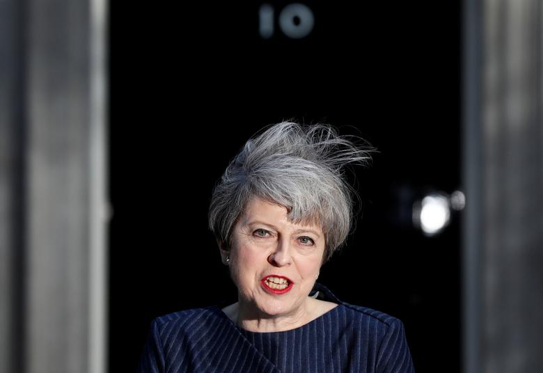 FILE PHOTO: Britain's Prime Minister Theresa May speaks to the media outside 10 Downing Street, in central London, Britain April 18, 2017.  REUTERS/Stefan Wermuth/File Photo