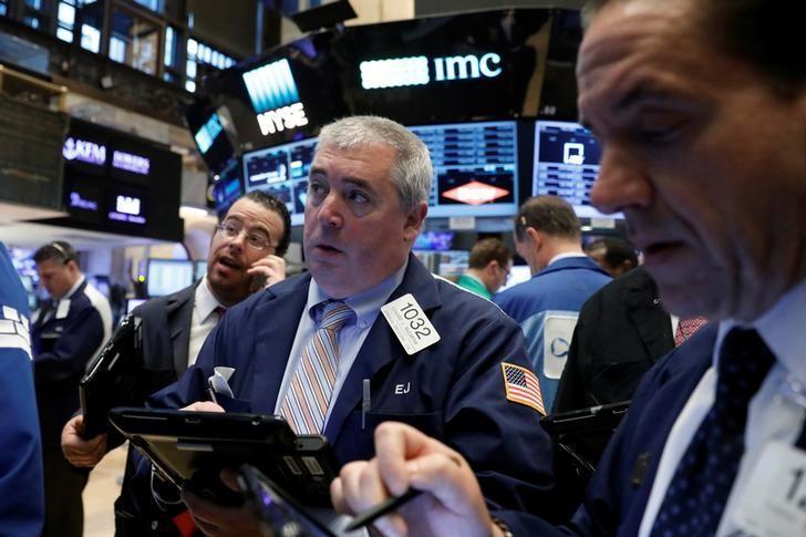Traders work on the floor of the New York Stock Exchange (NYSE) in New York, U.S., April 18, 2017. REUTERS/Brendan McDermid