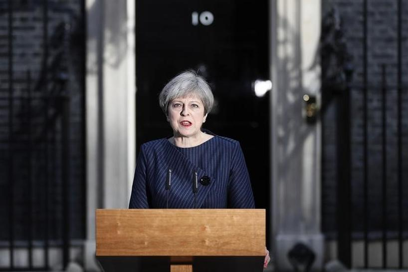 Britain's May wins parliament's backing for June 8 snap election