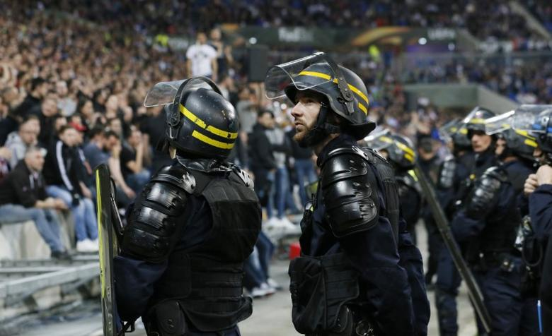 Football Soccer - Olympique Lyonnais v Besiktas - UEFA Europa League Quarter Final First Leg - Parc Olympique Lyonnais - 13/4/17 Police officers by the pitch after Lyon and Besiktas fans clashed in the stands Reuters / Robert Pratta Livepic