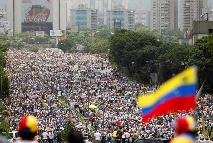 Venezuelan opposition marches against Maduro; student killed