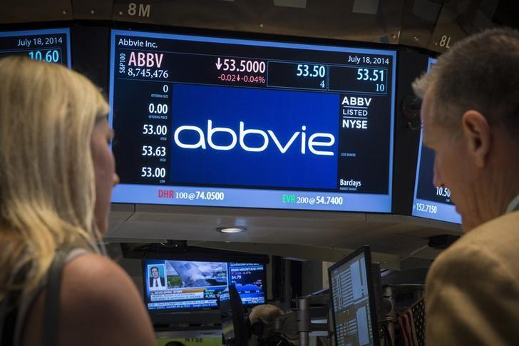 A screen displays the share price for pharmaceutical maker AbbVie on the floor of the New York Stock Exchange July 18, 2014. Shire said on July 18 that it had accepted an offer of 32 billion pounds ($54.7 billion) from AbbVie. REUTERS/Brendan McDermid