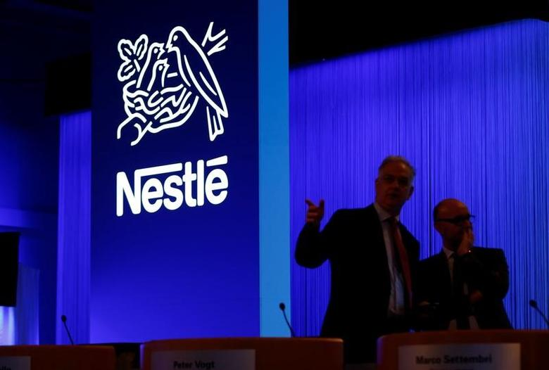 Nestle managers arrive before the shareholders meeting in Lausanne, Switzerland, April 6, 2017. REUTERS/Denis Balibouse