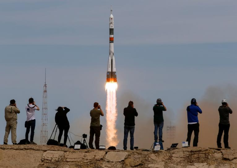 US-Russian crew reaches space station with 'awesomeness'