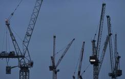 """Cranes are seen at dawn in the financial district of London, Britain, January 7, 2016. Britain's finance minister George Osborne said on Thursday that Britain's economy was not immune from a """"dangerous cocktail"""" of threats from abroad, and urged against complacency after two years of solid growth. Osborne -- whom Prime Minister David Cameron has named as a possible successor -- said in a new year's message that Britain faced headwinds from slower growth in China, Brazil and Russia as well as tensions in the Middle East. REUTERS/Toby Melville"""