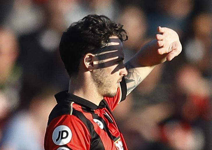 Britain Football Soccer - AFC Bournemouth v Chelsea - Premier League - Vitality Stadium - 8/4/17 Bournemouth's Adam Smith shields his eyes from the sun Reuters / Peter Nicholls Livepic
