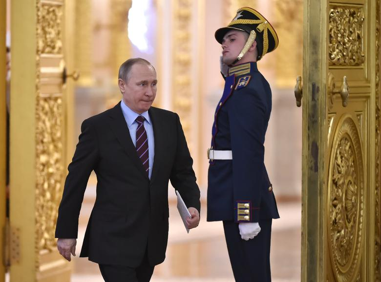 Russia's President Vladimir Putin arrives to chair a meeting of the Pobeda (Victory) Organising Committee, with a focus on developing humanitarian cooperation at the government and public level with other countries, in order to promote objective information on Russia's history and present, including its role in the victory over Nazism, at the Kremlin in Moscow on April 20, 2017. REUTERS/Alexander Nemenov/Pool