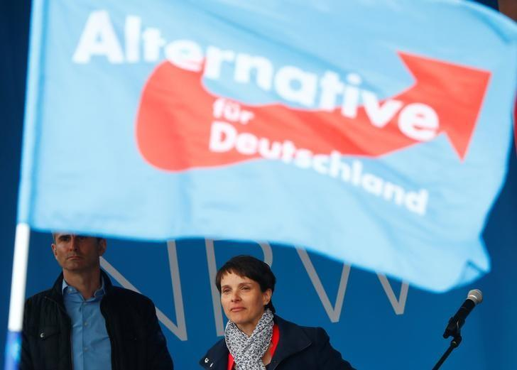 Anti-immigration party Alternative for Germany (AfD) chairwoman Frauke Petry stands under an AfD flag following her keynote speech at the AfD's election campaign launch for the upcoming North Rhine-Westphalian federal state elections in Essen, Germany April 8, 2017.   REUTERS/Wolfgang Rattay     TPX IMAGES OF THE DAY