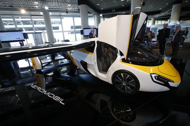 People look at the AeroMobil flying car during its unveiling at the Top Marques Monaco supercar show in Monaco April 20, 2017. REUTERS/Jean-Paul Pelissier