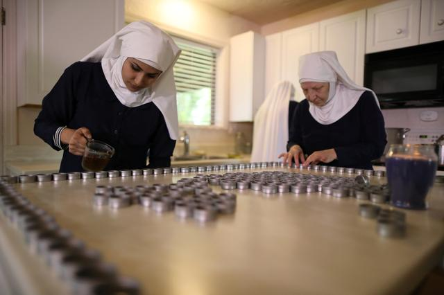 California ''weed nun'' Christine Meeusen, 57, who goes by the name Sister Kate (R), and Desiree Calderon, who goes by the name Sister Freya, pour CBD salve made from hemp at Sisters of the Valley near Merced, California, U.S., April 18, 2017.  REUTERS/Lucy Nicholson