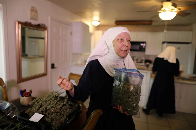 California ''weed nun'' Christine Meeusen, 57, who goes by the name Sister Kate, holds hemp in the kitchen at Sisters of the Valley near Merced, California, U.S., April 18, 2017.  REUTERS/Lucy Nicholson