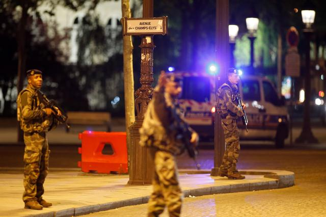 Armed soldiers secure the Champs Elysees Avenue after a shooting incident in Paris, France, April 20, 2017. REUTERS/Benoit Tessier