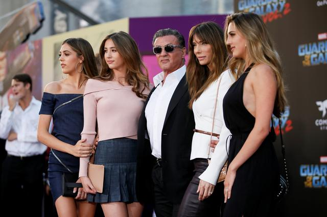 Actor Sylvester Stallone (C) poses with his daughters and his wife Jennifer Stallone (2nd-R). REUTERS/Danny Moloshok