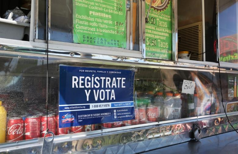 A voter registration sign is seen on a taco truck, as part of the U.S. Hispanic Chamber of Commerce's ''Guac the Vote'' campaign, in Houston, Texas, U.S. September 29, 2016. REUTERS/Trish Badger