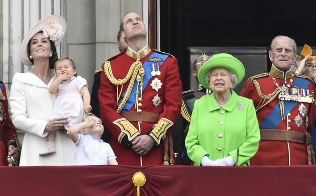 Members of the royal family, including Catherine, Duchess of Cambridge holding Princess Charlotte, Prince George, Prince William, Queen Elizabeth, and Prince Philip stand on the balcony of Buckingham Palace after the annual Trooping the Colour ceremony on Horseguards Parade in central London, Britain June 11, 2016. REUTERS/Toby Melville
