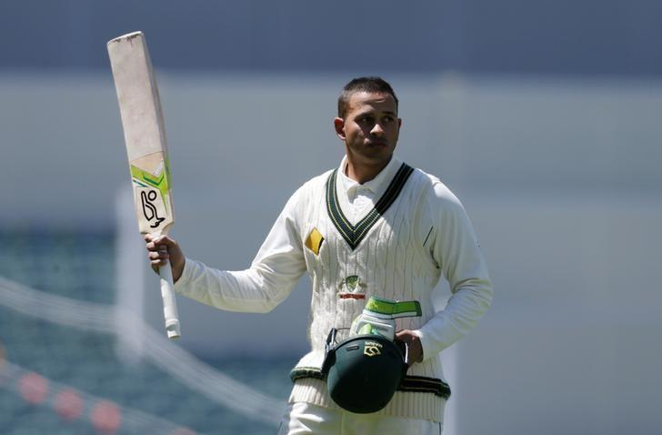 Cricket - Australia v South Africa - Third Test cricket match - Adelaide Oval, Adelaide, Australia - 26/11/16.  Australian batsman Usman Khawaja acknowledges the crowd as he walks off the field after being dismissed during the third day of the Third Test cricket match in Adelaide.  REUTERS/Jason Reed/Files