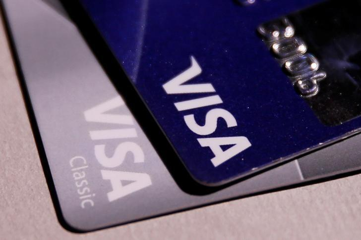 Visa credit cards are seen in this picture illustration taken June 9, 2016. REUTERS/Maxim Zmeyev/Illustration/File Photo   GLOBAL BUSINESS WEEK AHEAD PACKAGE - SEARCH ''BUSINESS WEEK AHEAD JULY 18'' FOR ALL IMAGES