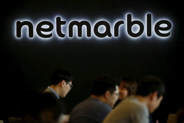 FILE PHOTO: The logo of Netmarble Games is seen at its headquarters in Seoul, South Korea, March 25, 2016.  REUTERS/Kim Hong-Ji/File Photo