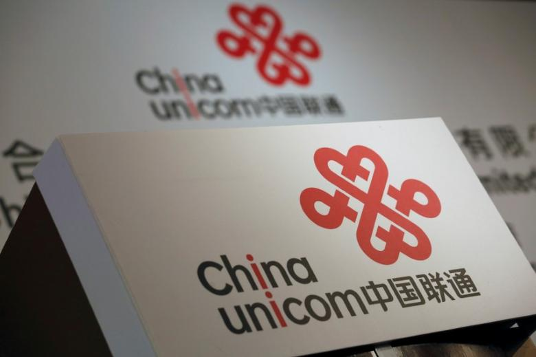 FILE PHOTO: Company logos of China Unicom are displayed at a news conference during the company's announcement of its annual results in Hong Kong, China March 16, 2016. REUTERS/Bobby Yip/File Photo