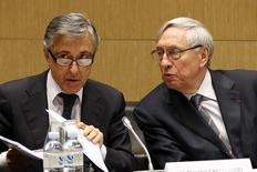 "Michel Cornil (R), Vice President of Ecomouv speaks to Giovanelli Castellucci (L), CEO of Autostrade, during a hearing by a French National Assembly commission in Paris, January 29, 2014. The ""ecotax"" is a new environmental tax on heavy goods vehicles which the French government hopes to implement, through which it aims to raise more than 1 billion euros ($1.38 billion) a year to finance mostly rail infrastructure projects.REUTERS/Charles Platiau (FRANCE - Tags: POLITICS BUSINESS) - RTX17ZMW"