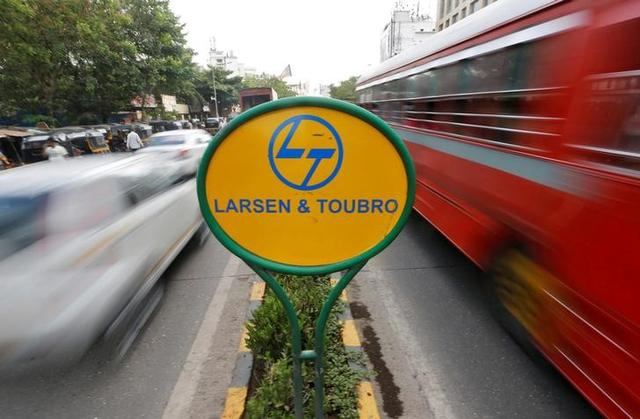 A sign of Larsen and Toubro (L&T) is placed on a road divider in Mumbai, May 25, 2016. REUTERS/Shailesh Andrade/File Photo