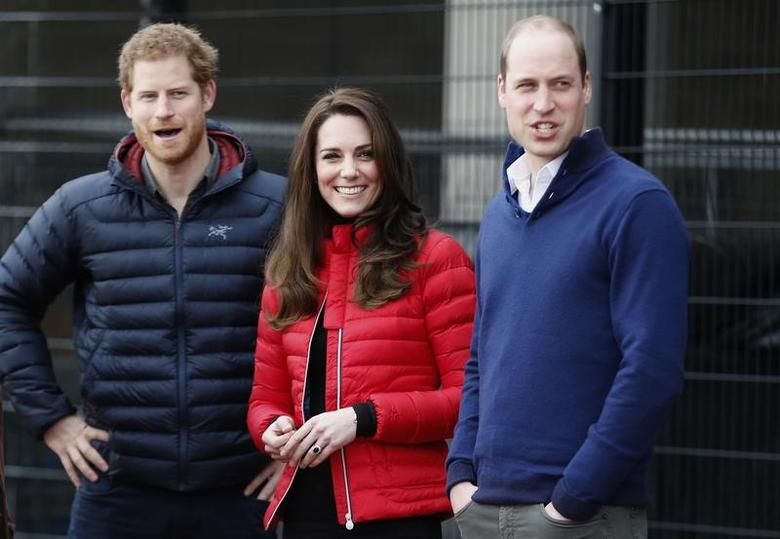 Britain's Prince William, Kate, Duchess of Cambridge, and Prince Harry look down the track as they arrive to take part in a relay race, during a training event to promote the charity Heads Together, at the Queen Elizabeth II Park in London, Britain, February 5, 2017. REUTERS/Alastair Grant/Pool