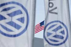 FILE PHOTO: An American flag flies next to a Volkswagen car dealership in San Diego, California September 23, 2015.   REUTERS/Mike Blake/File Photo