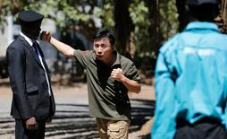 Chinese national Jack Wang, a security trainer at the Chinese-run Deway Security Group leads a Kenyan security guard in martial arts combat training at their company compound in Kenya's capital Nairobi, March 13, 2017. REUTERS/Thomas Mukoya