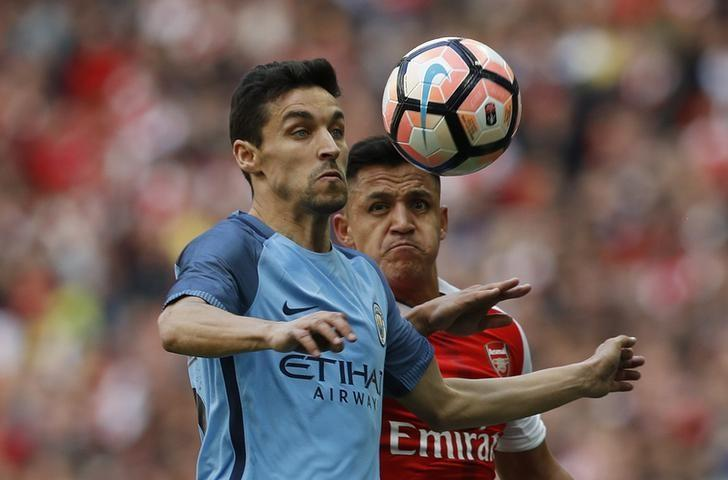 Britain Football Soccer - Arsenal v Manchester City - FA Cup Semi Final - Wembley Stadium - 23/4/17 Manchester City's Jesus Navas in action with Arsenal's Alexis Sanchez  Reuters / Darren Staples Livepic