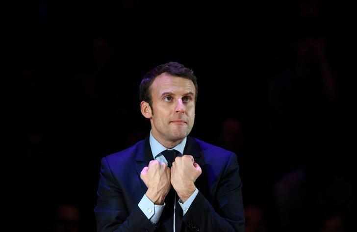 Emmanuel Macron, candidate in France's 2017 French presidential election, delivers an address for French nationals in London, Britain, February 21, 2017. REUTERS/Toby Melville