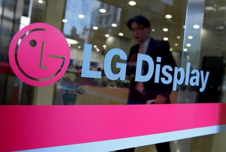 A man walks out of the headquarters of LG Display in Seoul, October 20, 2011.  REUTERS/Jo Yong-Hak/Files