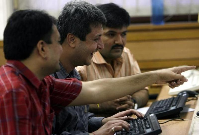 Sensex hits record high; rupee at 20-month high
