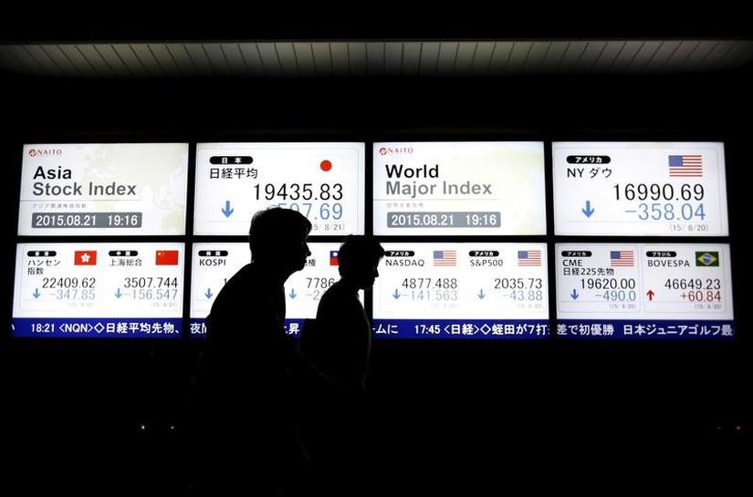 Asian shares retreat from highs after Trump tax plan