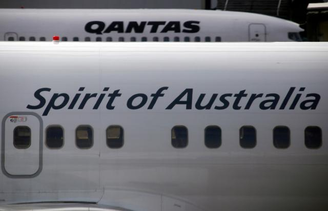 FILE PHOTO: Qantas Airways planes sit on the tarmac at Sydney's Kingsford Smith International Airport February 26, 2015.    REUTERS/David Gray/File Photo