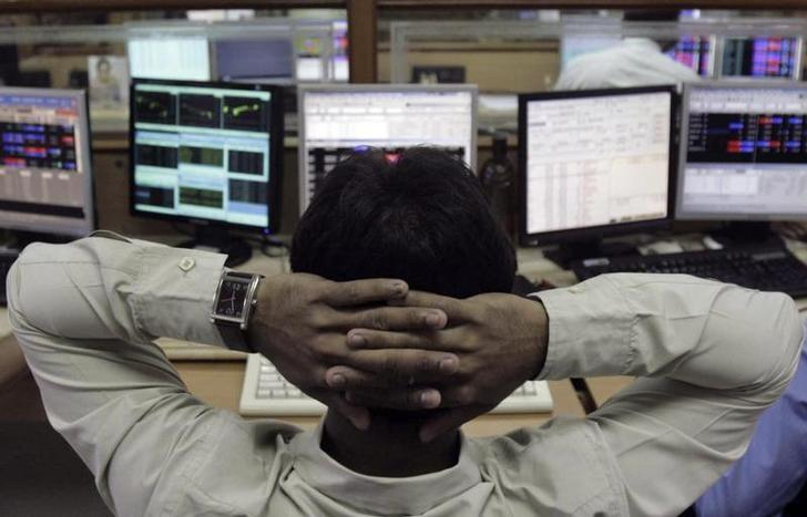 A broker monitors share prices at a brokerage firm in Mumbai August 8, 2011.  REUTERS/Stringer/Files Photo