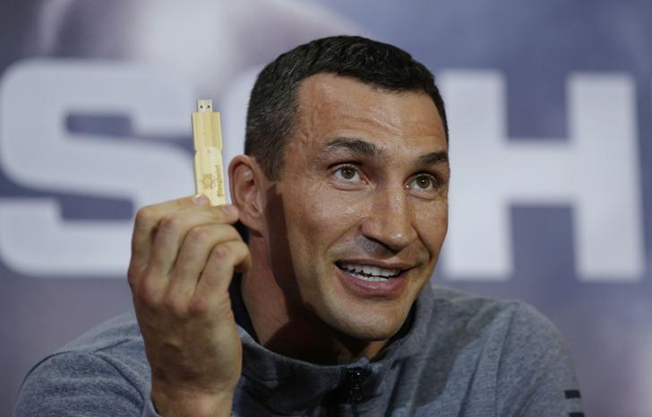 Britain Boxing - Anthony Joshua & Wladimir Klitschko Press Conference - Sky Central - 27/4/17 Wladimir Klitschko holds a USB stick with his prediction of the fight during the press conference Action Images via Reuters / Andrew Couldridge Livepic