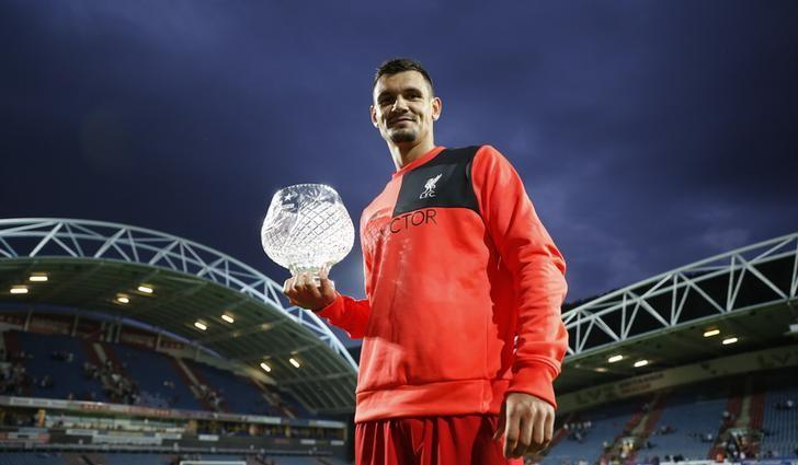 Britain Football Soccer - Huddersfield Town v Liverpool - Pre Season Friendly - John Smith's Stadium - 20/7/16Liverpool's Dejan Lovren celebrates with the Shankly Trophy at the end of the matchAction Images via Reuters / Carl Recine/Livepic/ Files