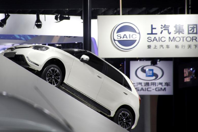 FILE PHOTO: SAIC Motor Corp's logos are pictured at its booth during the Auto China 2016 auto show in Beijing, China April 26, 2016. REUTERS/Kim Kyung-Hoon/File Photo