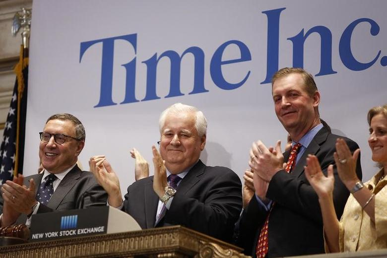 FILE PHOTO: Time Inc. CEO Joe Ripp (2nd L) claps after ringing the bell to open trading at the New York Stock Exchange in New York June 9, 2014. REUTERS/Carlo Allegri