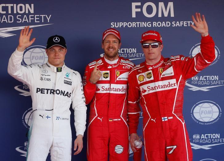 Formula One - F1 - Russian Grand Prix - Sochi, Russia - 29/04/17 - Mercedes Formula One driver Valtteri Bottas of Finland, Ferrari Formula One drivers Sebastian Vettel of Germany and Kimi Raikkonen of Finland wave after qualifying session. REUTERS/Maxim Shemetov