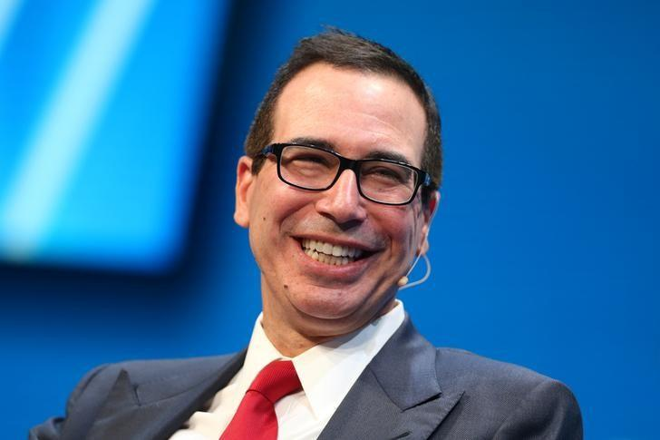 Steven Mnuchin, U.S. Treasury Secretary, laughs during the Milken Institute Global Conference in Beverly Hills, California, U.S., May 1, 2017. REUTERS/Lucy Nicholson