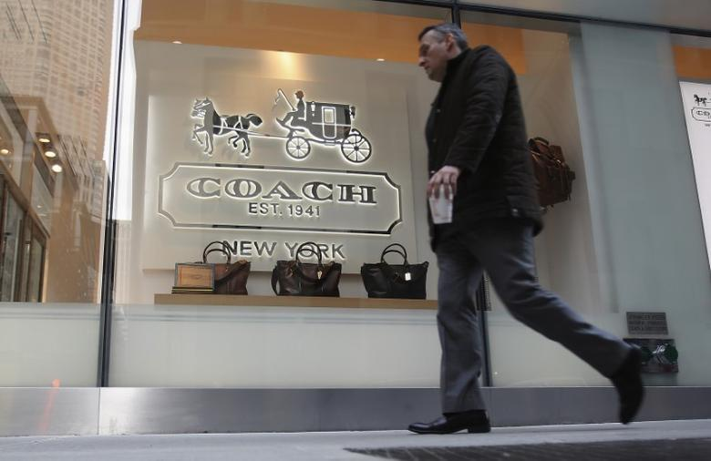 FILE PHOTO: A man walks past a Coach store on Madison Avenue in New York, January 23, 2013. REUTERS/Carlo Allegri