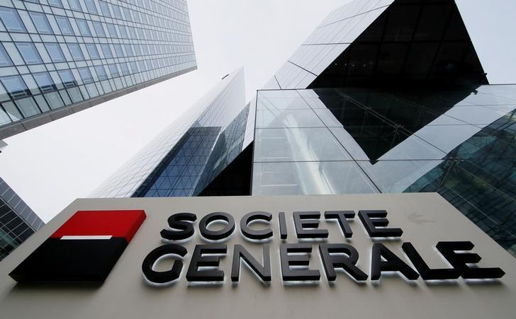 The logo of the French bank Societe Generale is seen in front of the bank's headquarters building at La Defense business and financial district in Courbevoie near Paris, France, April 21, 2016. REUTERS/Gonzalo Fuentes