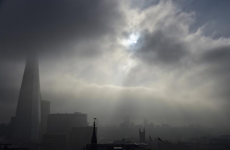 Fog is seen clearing around the Shard skyscraper in London, Britain, November 2, 2015.  REUTERS/Toby Melville