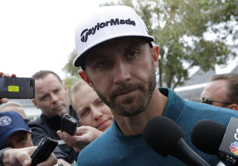 Dustin Johnson of the U.S. talks to members of the media after he pulled out of the tournament due to injury during first round play at the 2017 Masters golf tournament at Augusta National Golf Club in Augusta, Georgia, U.S., April 6, 2017. REUTERS/Mike Segar
