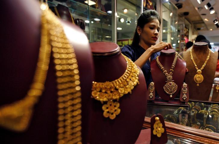 A salesperson attends to a customer (not pictured) inside a jewellery showroom, during Akshaya Tritiya, a major gold-buying festival, in Mumbai, April 28, 2017. REUTERS/Shailesh Andrade/Files
