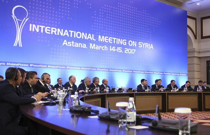 FILE PHOTO: Participants of Syria peace talks attend a meeting in Astana, Kazakhstan March 15, 2017. REUTERS/Mukhtar Kholdorbekov