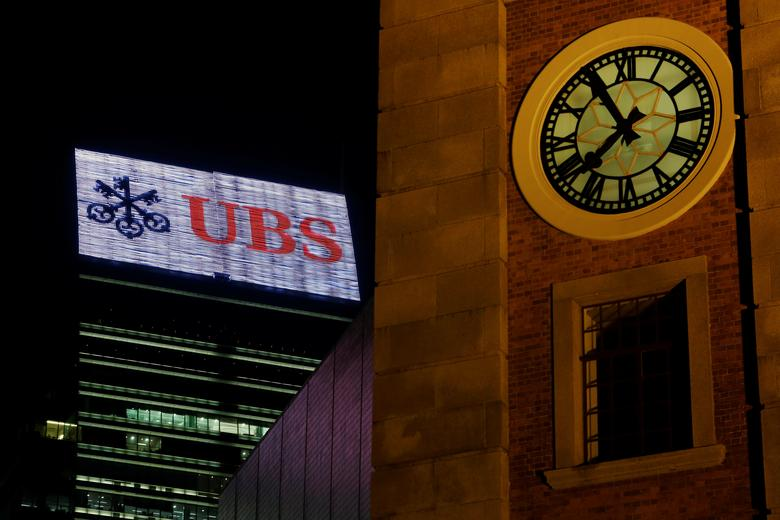 A UBS advertisement is displayed on top of a commercial building in Hong Kong, China May 2, 2017. Picture taken May 2, 2017. REUTERS/Bobby Yip